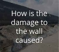 How is damage to the wall caused?